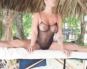 Flexible girl in see-through bodysuit doing yoga in public