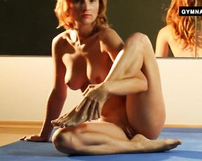 Naked mature redhead does nude yoga exercises