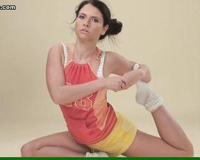 Big tits gymnast Polina does topless yoga exercises