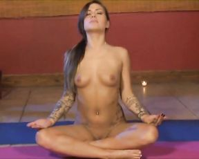 Nude tattoo girl doing yoga sex exercises on the floor