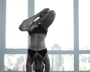 Flexible girl in lingerie does sexy yoga exercises
