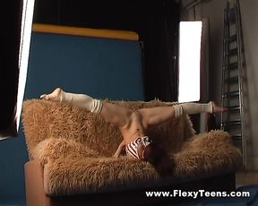 Nude gymnast in yoga sex poses on the couch