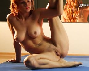 Naked redhead gymnast does yoga sex exercises in the gym