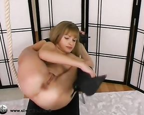 Porn yoga video with the naked contortionist in knee-high boots