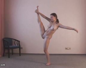 Naked teen with big tits does yoga porn exercises at home