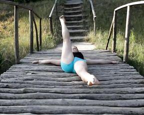 Erotic yoga with sexy gymnast Karina in public