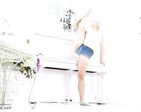 Sexy gymnast Karina in jean shorts