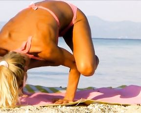 Sexy MILF does hot yoga on the ocean shore