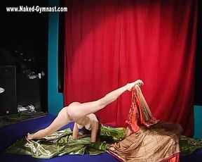 Nude gymnast demonstrates her naked yoga skill