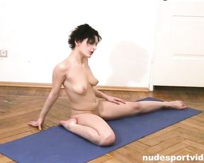 Naked girl with tattoo does erotic yoga exercises