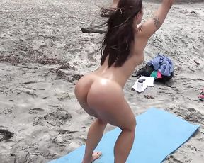 Sexy MILF does public naked yoga on the beach