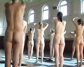 Group of young naked girls doing yoga