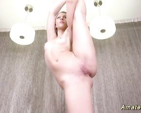 Nude yoga girl stretching her super flexible body