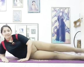 Asian mature lady in tight yoga pants