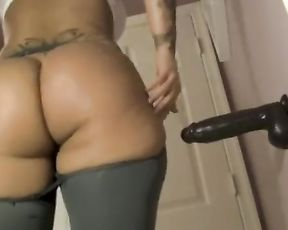 Big fat booty in see-through yoga pants fucks herself by big black dildo