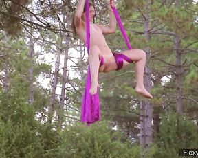 Nude contortionist displays naked yoga and hot gymnastics outdoor