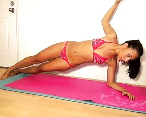 Sexy latina bikini model does hot yoga exercises