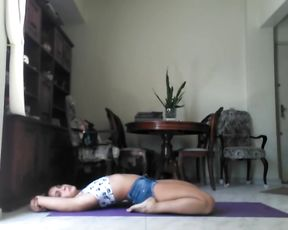 Pretty latin girl doing yoga on webcam