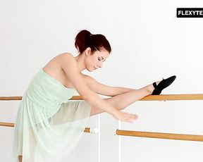Sexy redhead ballerina Zlata doing yoga exercises