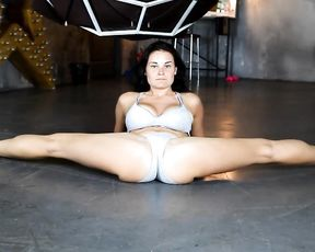 Sexy gymnast in lingerie does hot yoga routine