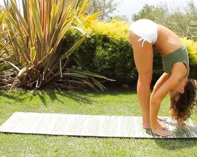 Sexy yoga teacher does hot exercises outside