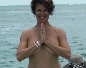 Nearly nude yoga with a sexy mature lady in public