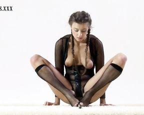 Nude gymnast does naked yoga in fishnet bodysuit