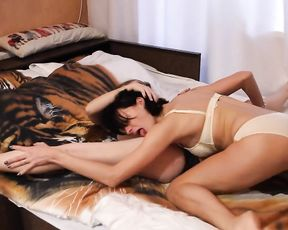 Sexy gymnasts in lingerie do lesbian yoga on the bed