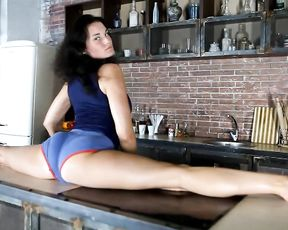 Sexy yoga video on the kitchen table