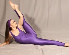 Beautiful flexible teen does sexy yoga in tight spandex bodysuit