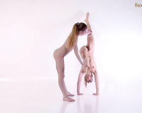 Naked gymnasts perform sensual lesbian yoga sex exercises