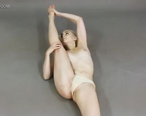 Topless female contortionist workouts in nude yoga video